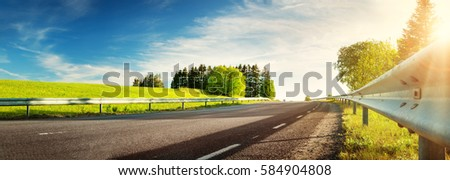 asphalt road panorama in countryside on sunny spring evening #584904808