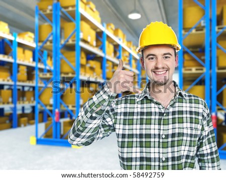 smiling worker in warehouse, call me pose #58492759