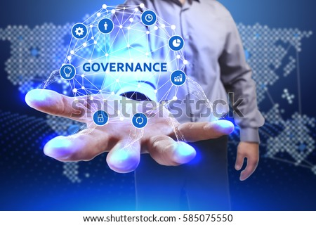Business, Technology, Internet and network concept. Young businessman shows the word on the virtual display of the future: Governance Royalty-Free Stock Photo #585075550