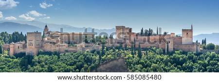 Alhambra in Granada, Andalusia. View of the world famous Alhambra with its Arab palaces and walls in southern Spain. #585085480