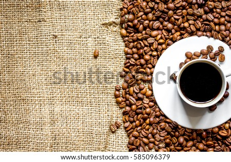 coffee beans, coffe cup on linen cloth background top view #585096379