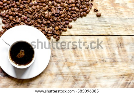 coffee beans on wooden with coffe cup table top view #585096385