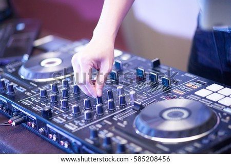 Dj playing the track at a party #585208456
