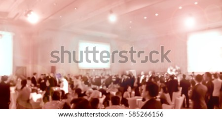 blurred brown people  eating and talking in hotel ballroom party #585266156