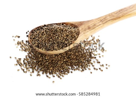 pile hemp seeds with wooden spoon isolated on white background #585284981