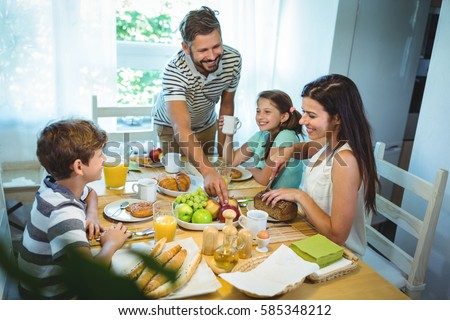 Happy family having breakfast together at home #585348212