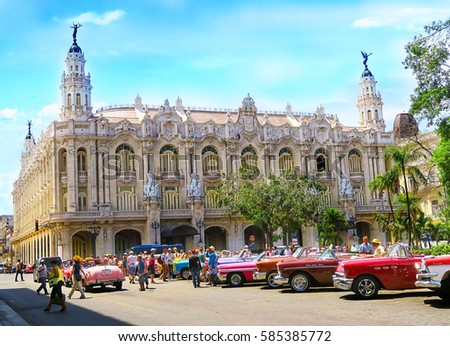 Cuba, Havana - 07 April, 2016: Cuban Capitol House, one of the most magnificent building of old Havana, beautiful architecture, with colorful taxis parked at its side waiting for tourists  #585385772