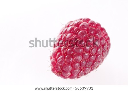 Raspberry with leaf against white background #58539901