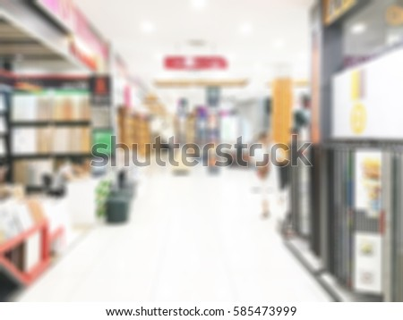 Abstract blurred photo of material store in shopping mall which have ceramic tile and wood tile, laminate , tile, vinyl, showroom materials concept #585473999