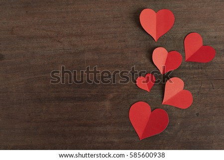 Red paper hearts media love putting on old Wooden