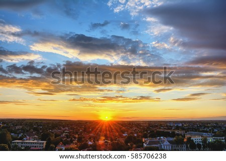 Sky and clouds at sunset over evening city. #585706238