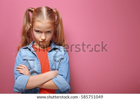 Emotional little girl on pink background #585751049