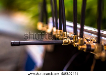 Beautiful shot of Radio signal Antenna of wireless connecting device used for networking purposes over internet or data transfer Royalty-Free Stock Photo #585809441