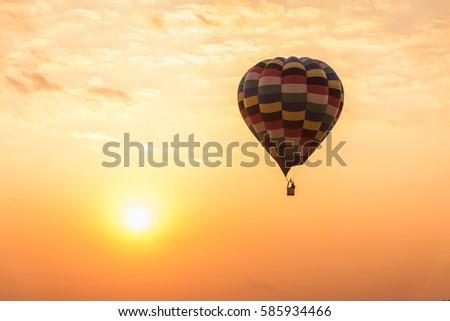 Balloons flying air over sunrise sky #585934466