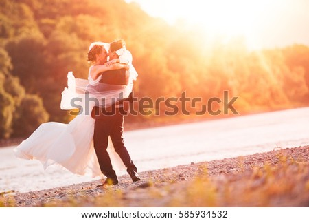 Just Married Couple Spinning on Beach Riverside Background #585934532