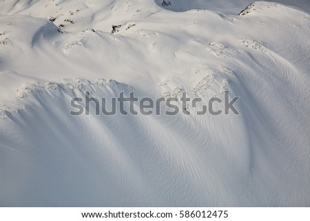 Scenic aerial landscape view of the beautiful snow covered mountains of British Columbia, Canada. Picture taken during winter near Whistler, BC. #586012475