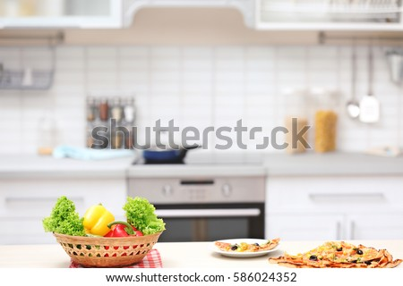 Vegetables and tasty pizza on kitchen table #586024352