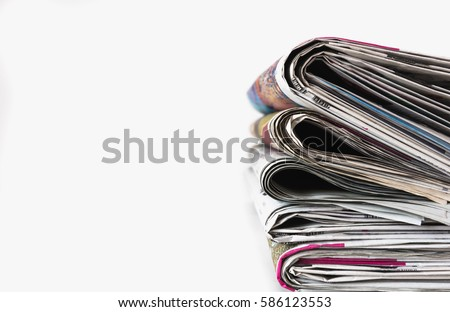 Stack of newspapers on white background. Royalty-Free Stock Photo #586123553
