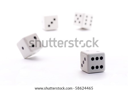 a roll of the dice in a game in a casino #58624465
