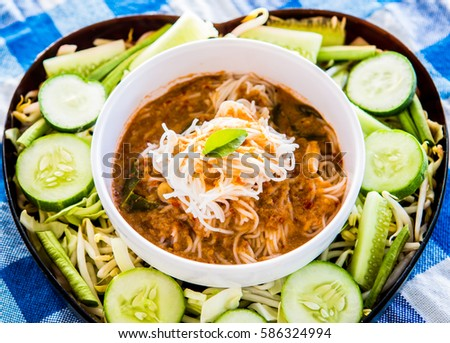 noodles with fish curry sauce or Kanom Jeen Nam Ya , Thai food #586324994