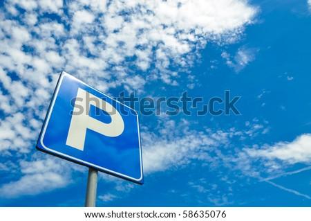 Parking signal over a blue sky