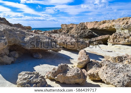 Drepanun Cape of Cyprus and Geronisos island near Agios Georgios Pegeia village. Mediterranean coast of Cyprus island #586439717