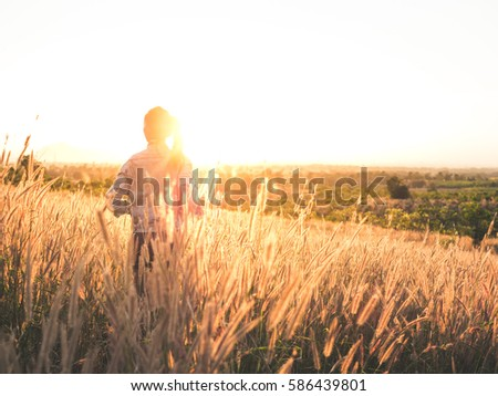Beautiful Young Woman in a field. #586439801