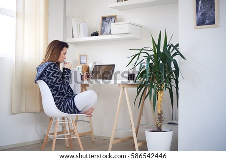 businesswoman entrepreneur working on laptop from home office space #586542446