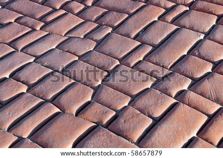 Background, texture or abstract: Paving stones with dramatic oblique lighting #58657879