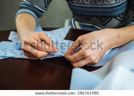 Close-up of woman's hand stitching quilting #586761980