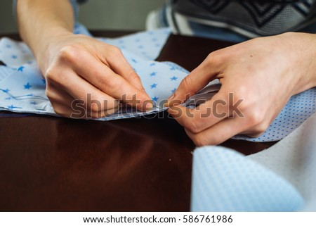 Close-up of woman's hand stitching quilting #586761986