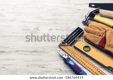 Variety of repair tools on wooden surface #586764419