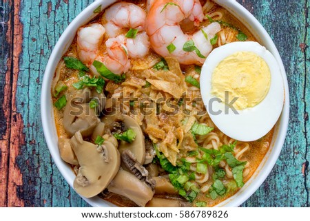 Hot and spicy noodle / tom yum noodles soup  #586789826