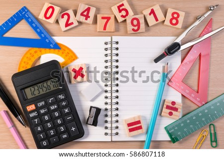 Pen and abacus over school note book for mathematics class in school. Mathematics book and mathematics tools for kids learning basic math. #586807118