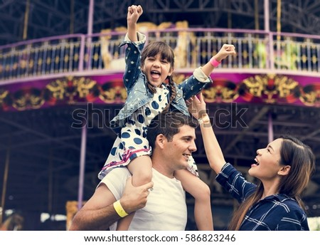 Family Holiday Vacation Amusement Park Togetherness Royalty-Free Stock Photo #586823246