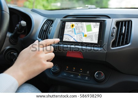 Man hand touching to screen multimedia system with  application navigation Royalty-Free Stock Photo #586938290