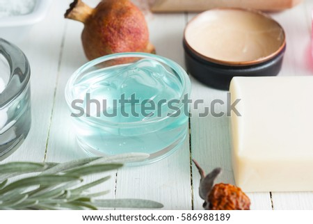 beauty product samples on white wooden table background #586988189