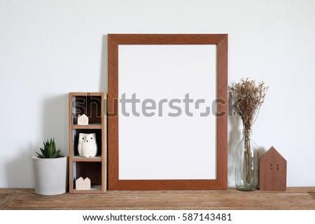 mock up frame on wooden shelf.home decoration