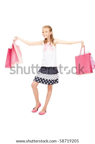 happy girl with shopping bags over white #58719205