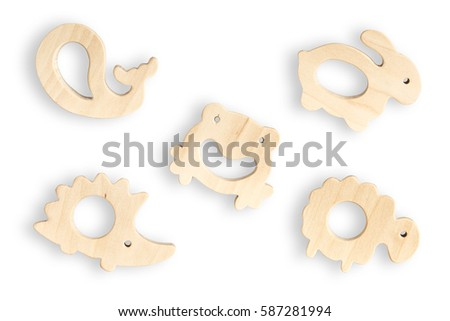 Organic baby teethers isolated on white background. Wooden animal toys set for babies. #587281994