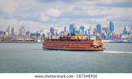 Staten Island Ferry and Lower Manhattan Skyline - New York, USA Royalty-Free Stock Photo #587348906