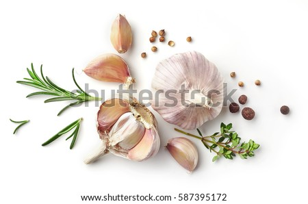garlic and herbs isolated on white background, top view Royalty-Free Stock Photo #587395172