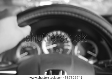 Picture blurred  for background abstract and can be illustration to article of hand drive wheel car #587523749