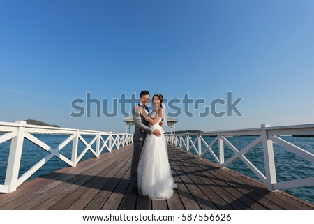 Pre Wedding photography thai couples on a wooden Atsadang bridge of Koh Si Chang Island at Thailand in concept love of memory.