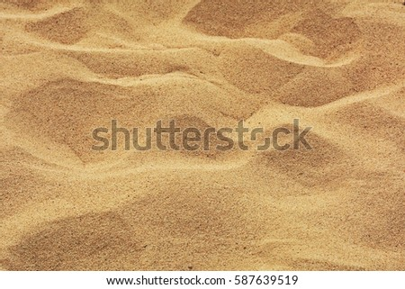 closeup of sand pattern of a beach in the summer #587639519