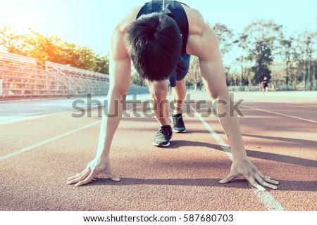 Sport. Sprinter leaving starting blocks on the running track