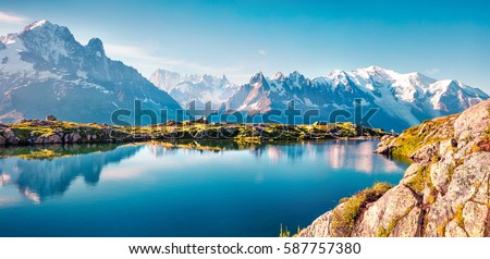 Colorful summer panorama of the Lac Blanc lake with Mont Blanc (Monte Bianco) on background, Chamonix location. Beautiful outdoor scene in Vallon de Berard Nature Reserve, Graian Alps, France, Europe. #587757380