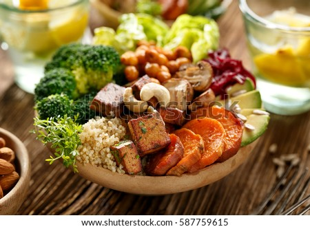 Buddha bowl of mixed vegetables, healthy and nutritious vegan meal Royalty-Free Stock Photo #587759615