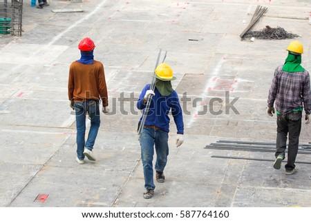 Worker bring steel in site construction #587764160
