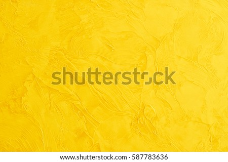 yellow colored Wall Texture Background, marble by the Venetian plaster  Royalty-Free Stock Photo #587783636